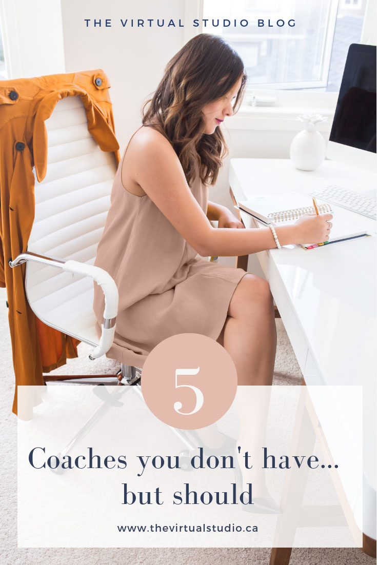 A successful business woman working at her desk and the words 5 Coaches You Don't Have But Should