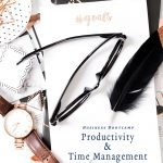The desk of a successful business woman with her goals notepad, glasses and watch with the words free bootcamp productivity and time management