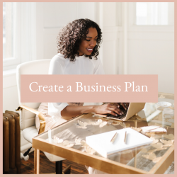 woman working at her desk Step by step guide to writing your business plan with the virtual studio's path to success series. Free Resources
