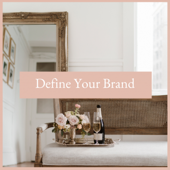 Woman's executive office with a mirror, bench and table. On the table is flowers, champagne and glass flutes. Define your brand identity free resources