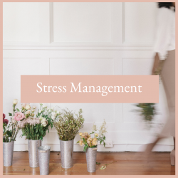 Multiple bouquets of flowers on the floor of a executive woman's office with a blurred woman walking out of the frame holding a bouquet of flowers. Stress management for the entrepreneur free resources