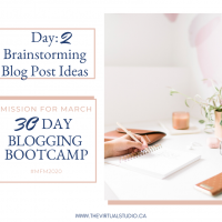 Woman brainstorming at her desk and computer doing the 30 day blogging bootcamp