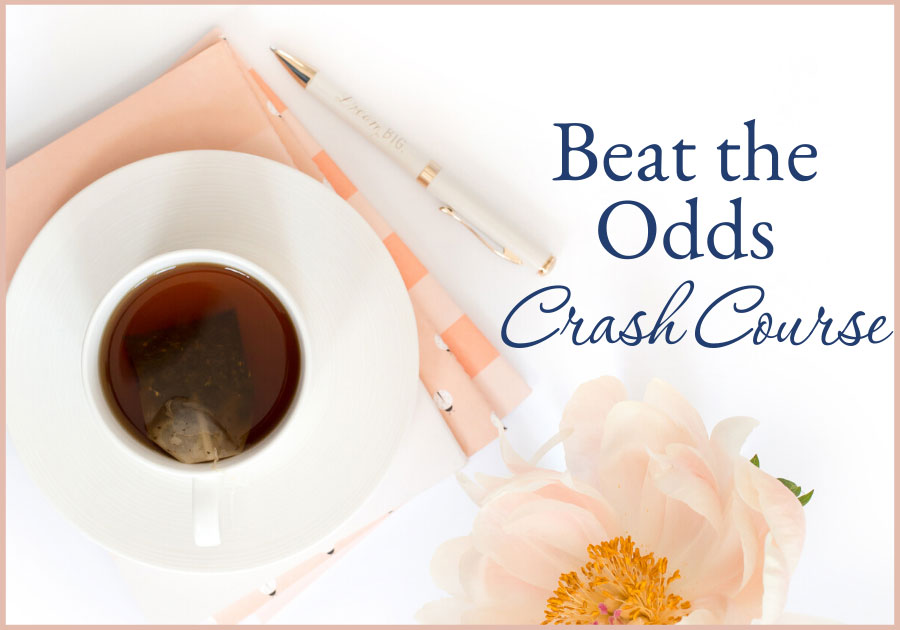 woman's desk top with a cup of tea, flower and notebook beat the odds crash course bootcamp business training resources