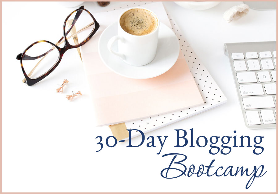 top of woman's desk with glasses, notebook, earrings, espresso, and 30 day blogging bootcamp