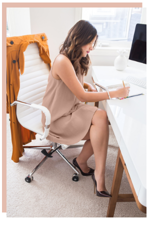 a business coach; business coaching; female business coach working at her desk inside the virtual studio