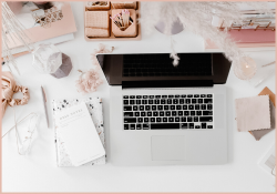 Top of a woman's work desk. Introducing Start Your Own Business Bundle with boss babe joelene Mills and the art of business startup program,