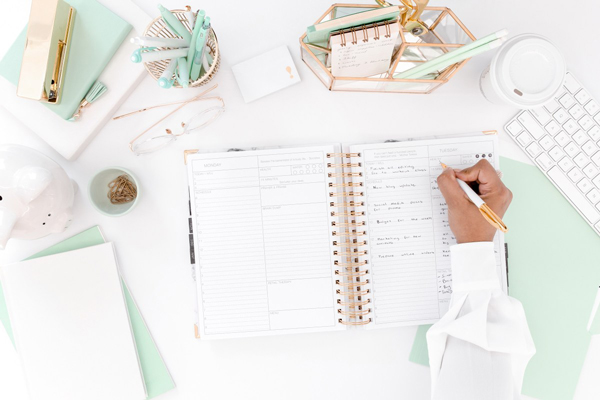 woman working at her desk on her business budgeting masterclass