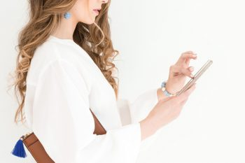 woman on her phone, getting started with instagram masterclass