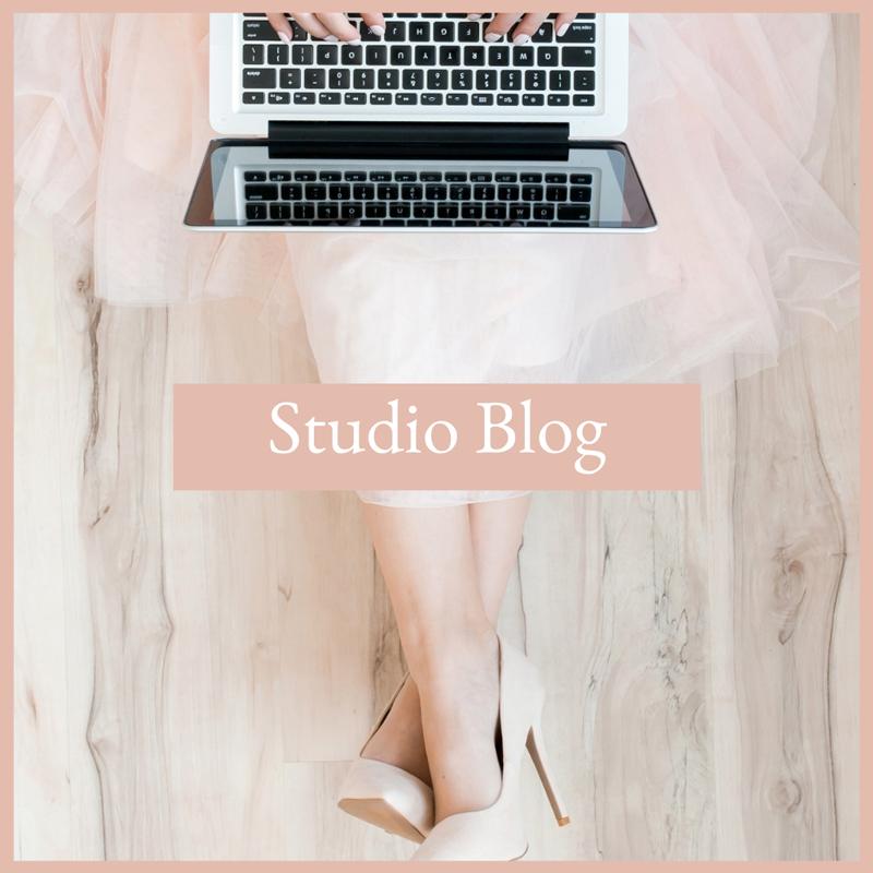 woman sitting on the floor wearing high heels working on her laptop, studio blog, resources