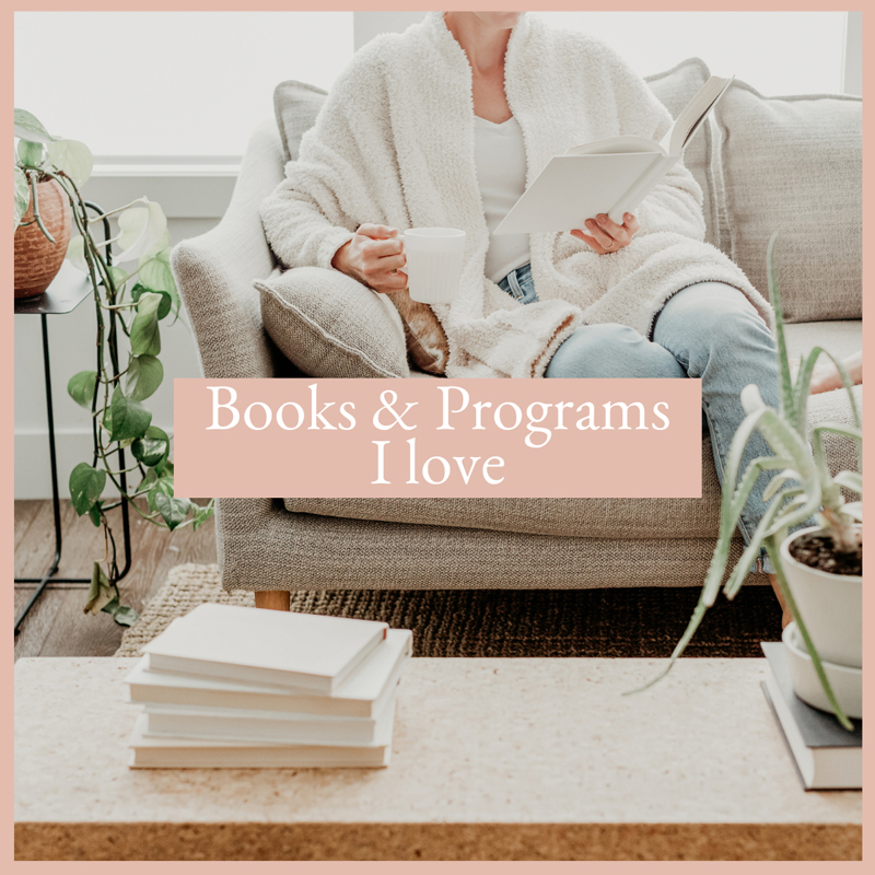 woman sitting on the couch reading and drinking tea, books and programs I love, resources